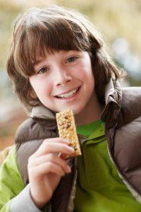 Child Snacking on Cereal Bar