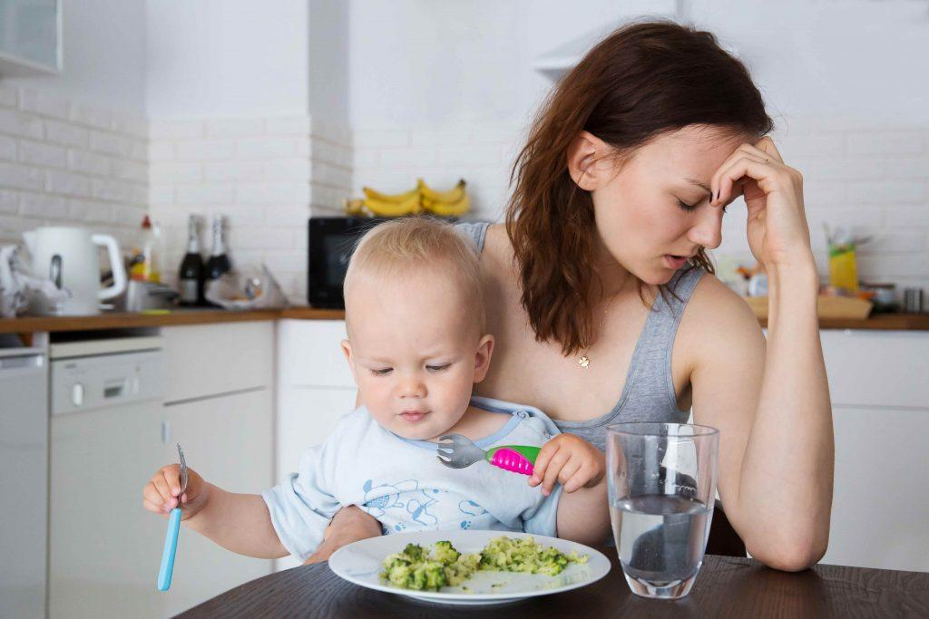 Frustrated Mom Feeding Baby