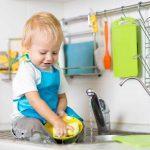 Washing Baby Feeding Supplies. Toddler washes dishes