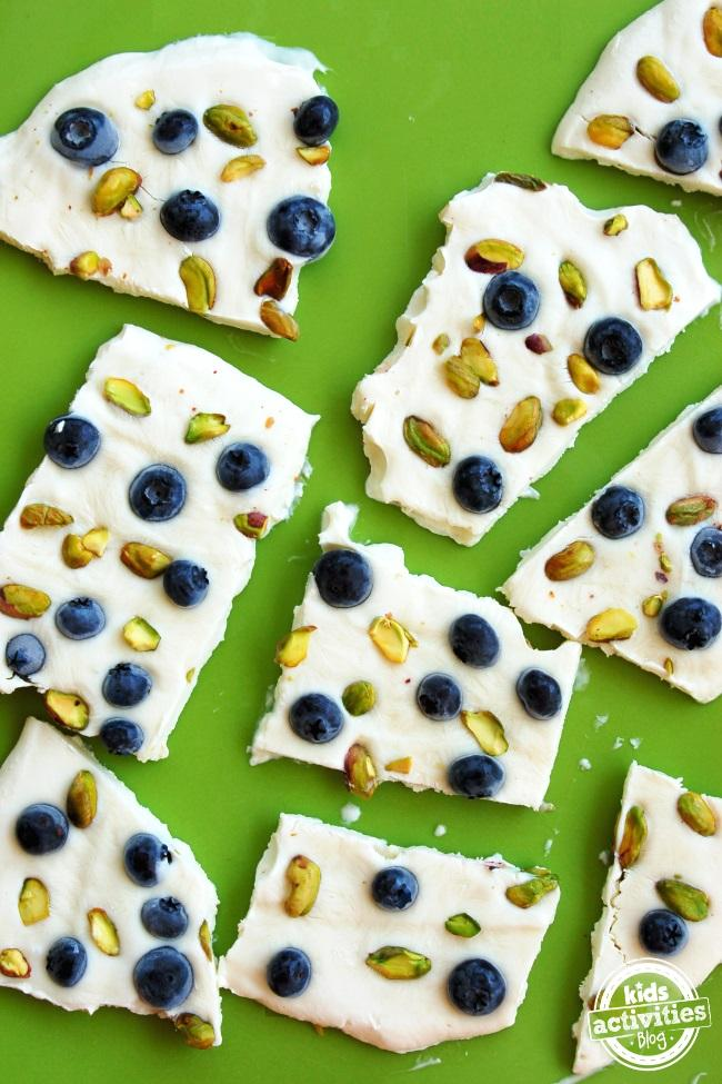 Yogurt Bark. So easy to make! Mix and match the toppings to your child's preferences. Perfect for after school!