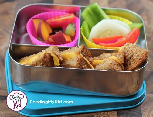 Back to School Lunch Ideas- Grilled Cheese and Veggie Dippers. A great way to make a basic grilled cheese sandwich more fun! Paired with a side of veggies this is a fully dippable lunch!
