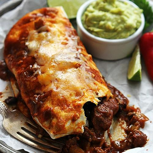 Smothered Chile Colorado Burritos22 Amazing Mexican Recipes: Theme Night Ideas - Try our Smothered Chile Colorado Burritos recipe! And check out the rest of what we have to offer: From authentic Mexican corn tamales to caramel apple empanadas, the unique taste of the Mexican culture will make you want more!