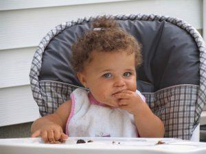 Baby-Girl-Eating-in-High-Chair-low-res