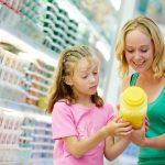 Grocery Shopping with Kids Looking at Food Labels