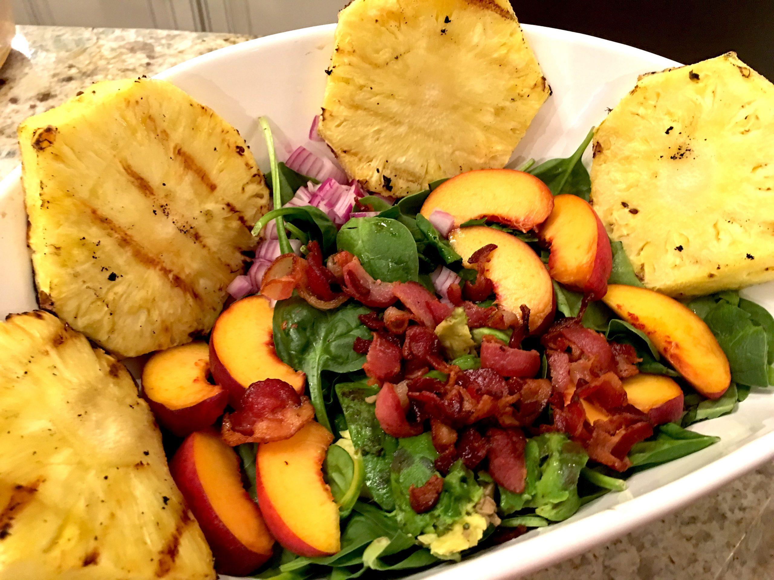 This peach salad is the perfect summertime meal! It's refreshing and filled with the great combo of avocado and bacon. Yum!