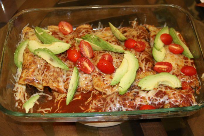 These chicken enchiladas use whole ingredients and are completely homemade. They make a great weeknight dinner, potluck dish, or dinner party dish.