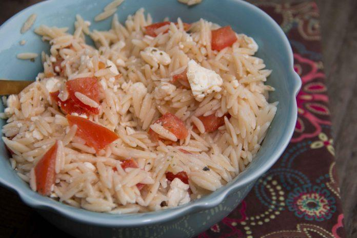 This easy orzo salad combines salty feta cheese with fresh cherry tomatoes. Super easy and goes great with a ton of meals!